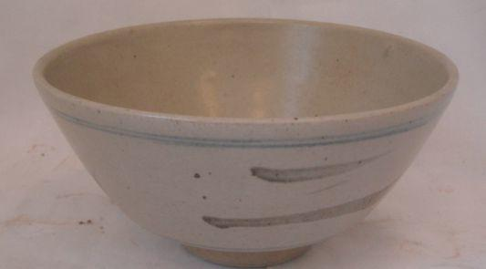 A Leach pottery stoneware bowl, A Leach pottery stoneware bowl,flared circular decorated with black dashes within fine blue lines on a sandy coloured ground, impressed mark, 23cm.