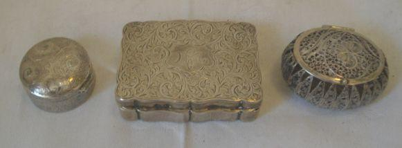 A silver box, with engraved hinged lid, Birmingham 1930, a modern silver pill box with engraved lid and a filigree box. (3)