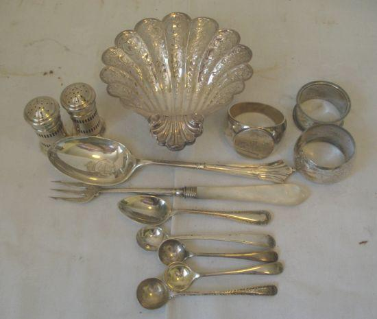 A silver Presentation spoon, the bowl engraved with the Royal Garter crest and 'Wick Hill House Bracknell Berks', 1924-Wick Hill House was the home of St George Littledale explorer, an embossed shell shaped dish on three scroll feet, Sheffield 1975, three various napkin rings, two pepperettes, five various spoons and silver bladed pickle fork.