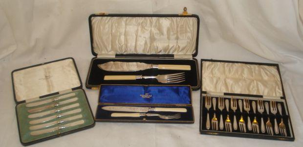 A cased silver bladed cake knife and fork, with ivory handles, by Walker & Hall, Sheffield 1906, a cased set of six silver bladed tea knives with mother of pearl handles, Sheffield 1920, a set of twelve silver cake forks, Birmingham 1927 and a cased pair of plated fish servers with ivory handles.