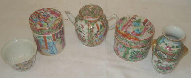 A Chinese teapot, of small size, decorated in the 'famille rose' palette with figures in shaped panels on a brocade ground, 12cm, a small baluster vase, two cylindrical pots and covers and an 18th Century Chinese Export teabowl.