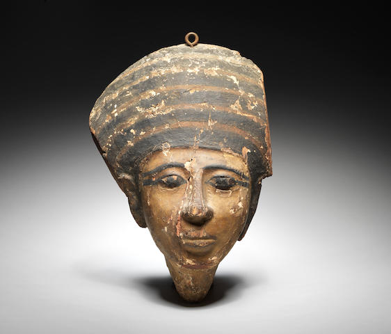 An Egyptian wood gesso-painted mummy mask