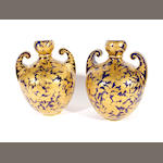 A pair of Derby Crown Porcelain twin handled vases, one dated 1887