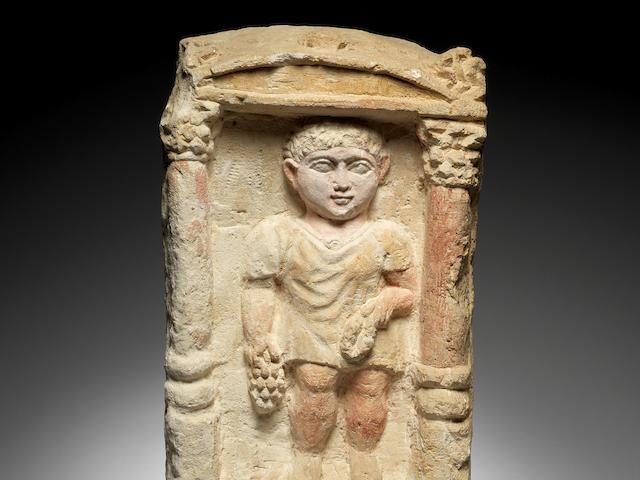 A Coptic limestone funerary stele
