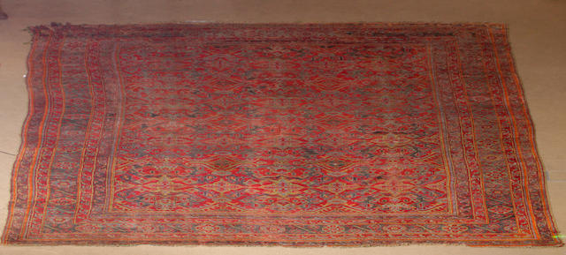 A large Turkey carpet probably late 19th century 638cm x 407cm