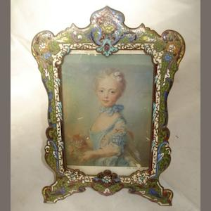 A late 19th Century bronze easel photograph frame, champleve enamel decorated in green, red and cream, 19cm.