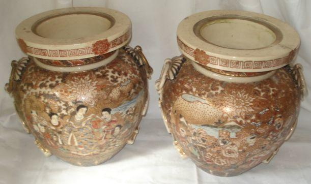 A large pair of Japanese Satsuma decorated globular shaped jars, with 'tied cord', handle, enamelled and gilt with panels of figures on a brocode ground, lacking original covers, 37cm.