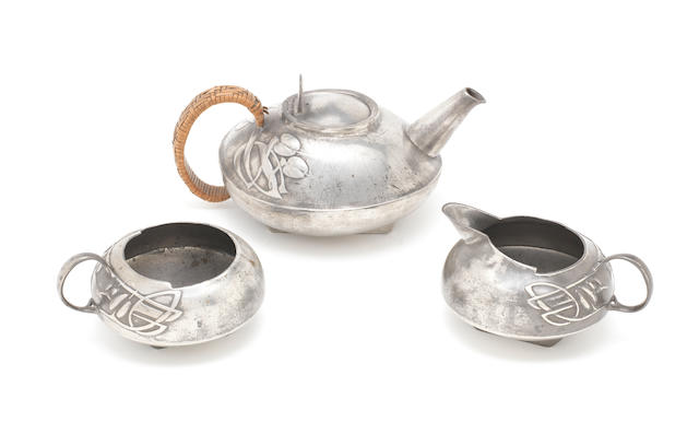 Archibald Knox for Liberty & Co. A Three-piece Tudric Tea Service, circa 1905