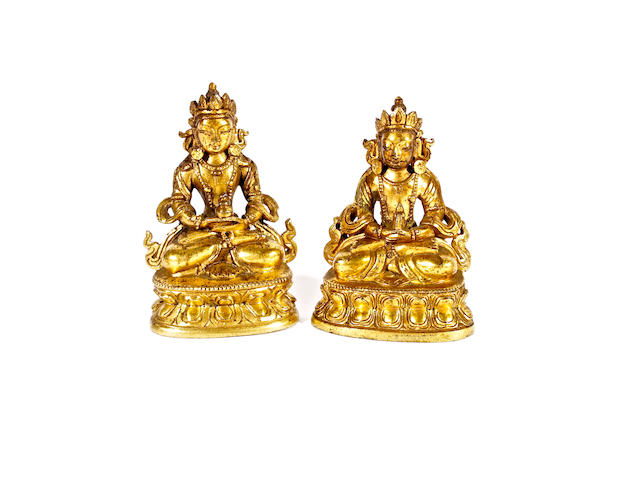 A pair of Sino-Tibetan gilt bronze miniature figures of Amitayus, 18th century