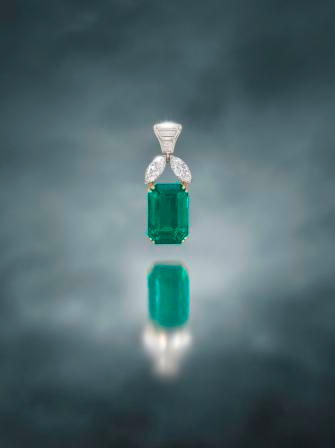 An important emerald and diamond pendant