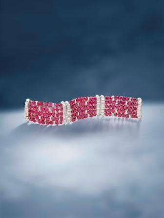A magnificent ruby and diamond strap bracelet, by Van Cleef & Arpels,