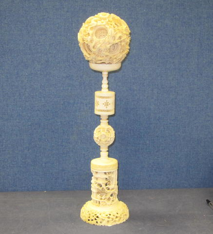A Cantonese carved ivory 'puzzle ball' on stand