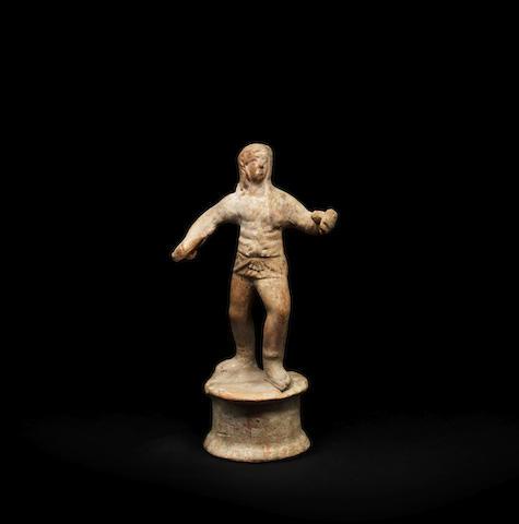 A Roman terracotta figure of a gladiator