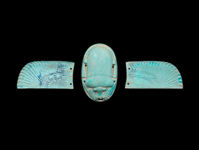 An Egyptian turquoise glazed composition winged scarab