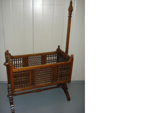 A 19th century carved and pierced cradle