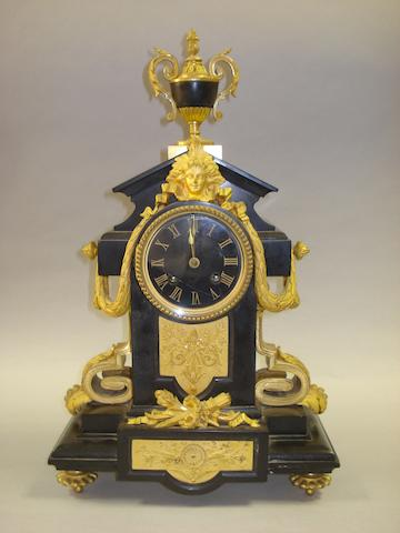 A 19th century French black marble and gilt brass mantel clock