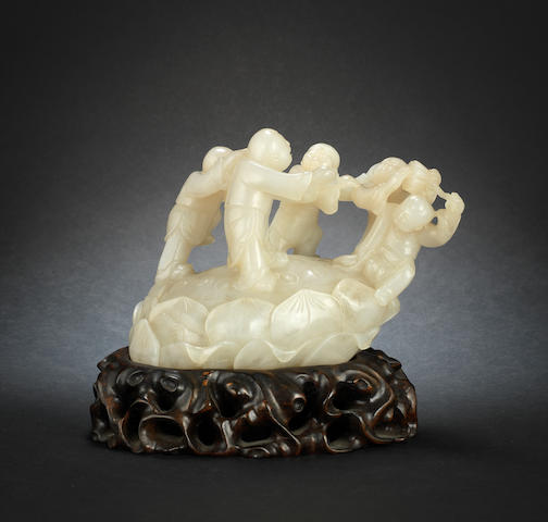 A large jade carving of boys