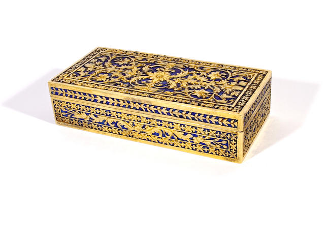 A gilt metal rectangular box and cover and a soapstone seal