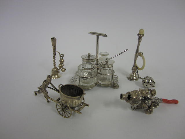 A Victorian silver child's rattle with coral handle  Birmingham 1865