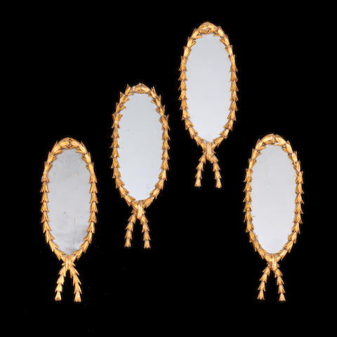 A set of four late 19th/early 20th century giltwood hall mirrors in the Louis XVI style