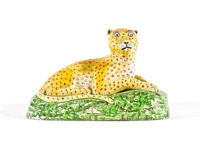 A Staffordshire model of a leopard, circa 1820-30