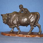 A Japanese bronze sculpture of a boy on a buffalo  Meiji Period