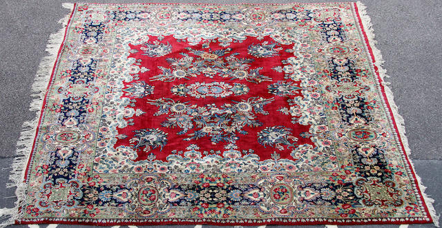 A bordered and fringe carpet, 299 x 282cm