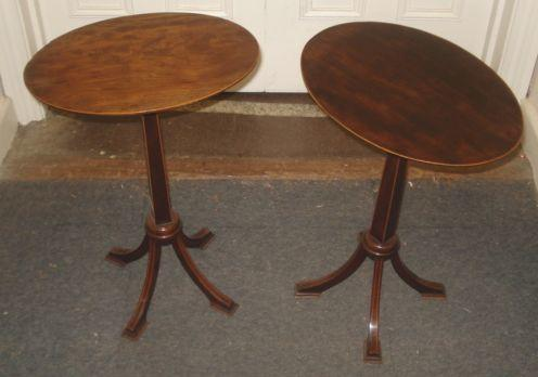 A pair of Edwardian mahogany boxwood strung wine tables,in George III style, the oval tops on tapered square pillars and quadripartite bases, 36cm and a George III style mahogany oval tray with undulating gallery. (3)