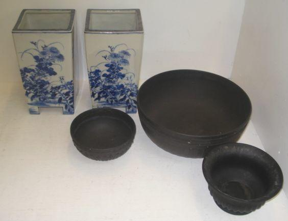 A pair of Japanese Seto ware blue and white vases, of tapering square form, decorated around the sides with flowering branches, 26cm and three Wedgwood black jasper ware bowls. (5)