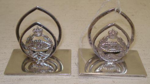 A pair of silver Tank Regiment menu holders, Garrard & Co, Birmingham 1959.