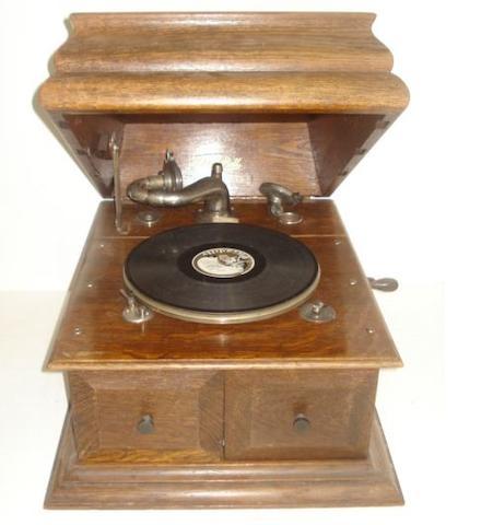 An Edison-Bell oak cased wind-up gramophone.