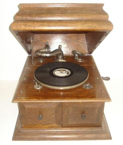 An Edison-Bell oak cased wind-up gramophone.