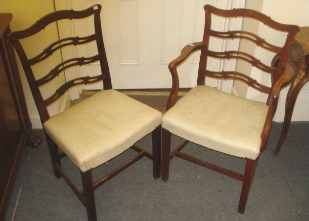 A set of six George III style mahogany dining chairs, with pierced ladder backs, stuff over seats, on square chamfered legs united by stretchers, to include an elbow chair.