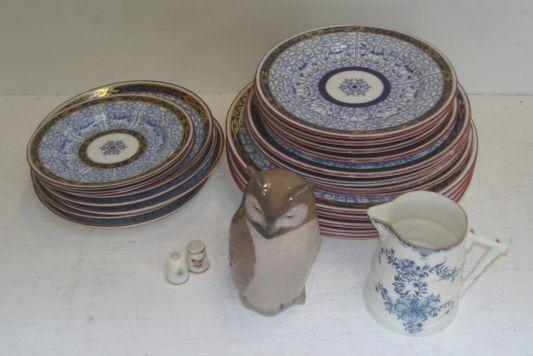 Twenty one Royal Worcester Queen Charlotte pattern plates and saucers, in graduated sizes, Royal Worcester barrel shape cream jug, two Royal Worcester thimbles also a Royal Copenhagen figure of an owl, shape no. 2999.