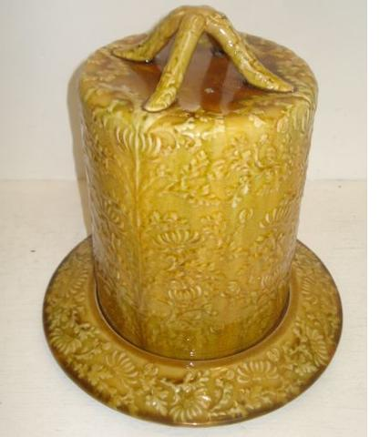 A Linthorpe pottery cheese dome and stand, 33cm high.