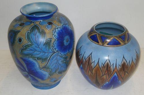 Two Chameleon ware hand painted vases, 29 & 22cm high respectively.