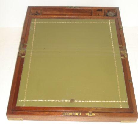 A Victorian campaign style mahogany brass bound writing box, the fitted interior with glass inkwells, a drawer below,40.5cm.