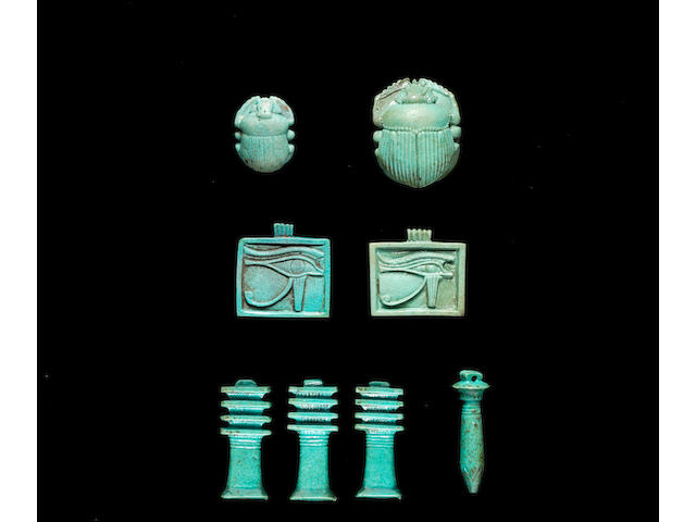 Eight Egyptian turquoise glazed composition amulets  8