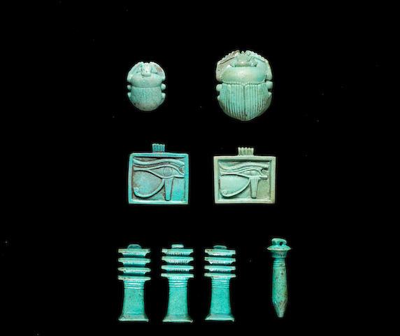 Eight Egyptian turquoise glazed composition amulets  8