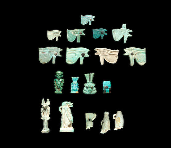 A group of Egyptian glazed composition amulets 18