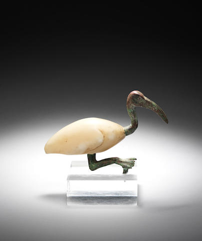 An Egyptian alabaster and bronze ibis
