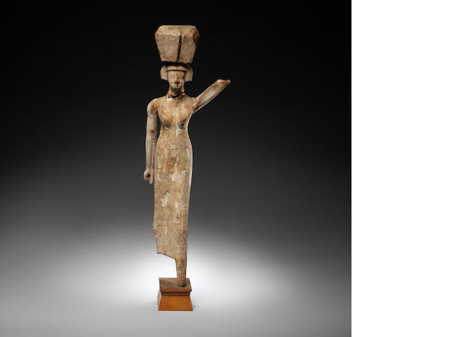 An Egyptian wood figure of a female offering-bearer