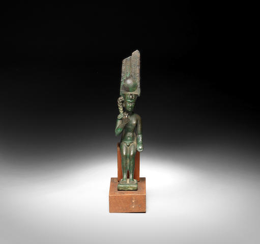 An Egyptian bronze figure of Harpokrates