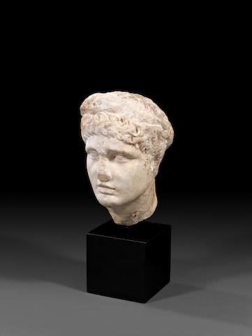 A Roman marble portrait head of a youth
