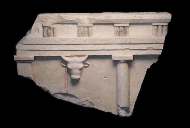 An Egyptian polychrome limestone architectural relief