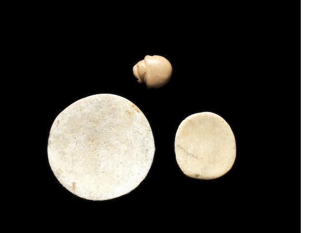 A Mesopotamian calcite stone stamp seal  and two miniature Anatolian marble dishes, 3