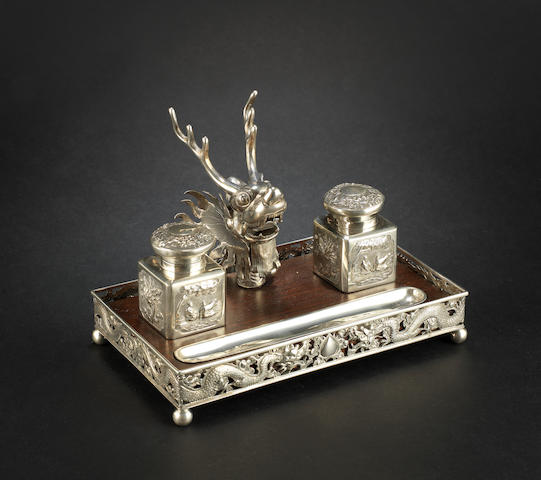 A white metal, pen and ink-holder set The tray marked 'MT' beside a three-character mark