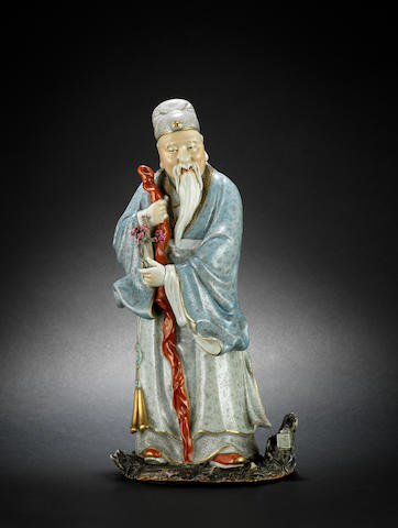 A glazed figure of a standing scholar Four-character mark