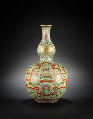 A pale green-ground, double gourd vase Qianlong six-character mark