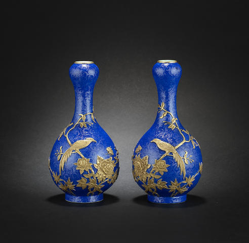 A small pair of blue-ground vases Qianlong six-character marks